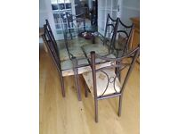 Wrought iron and glass table with 6 upholstered dining chairs