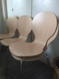 4 Keeler Stacking Dining Chairs, formed bent natural plywood.
