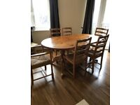 Pine Dining Room Table and six matching chairs