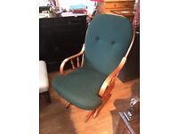 Glider armchair , wooden frame , green material .feel free to view, Free local delivery.