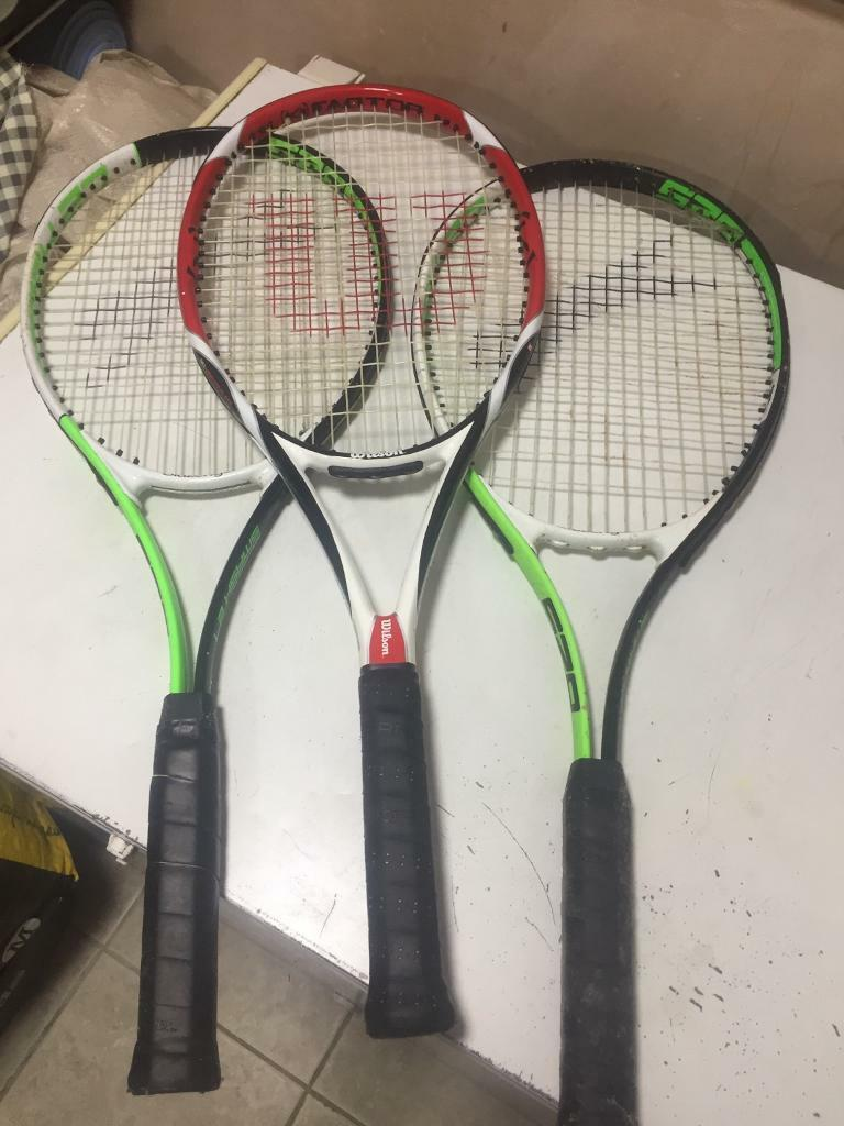 2 slazenger and 1 wilson tennis racket