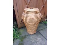 Wicker vase laundry basket.