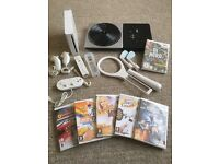 Nintendo Wii Console + 2 Controllers + 6 Games + Sports Pack + DJ Turntable