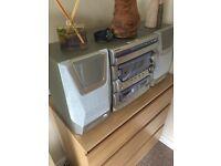 Sound system, 3 CD, radio, 2 tape decks