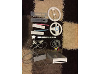 Nintendo Wii White Console, games and contollers