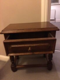 Solid dark wood bedside table with drawer