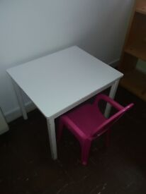 wooden table and plastic chair