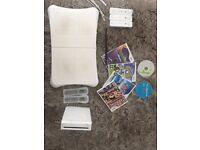Nintendo wii with wii fit board & games