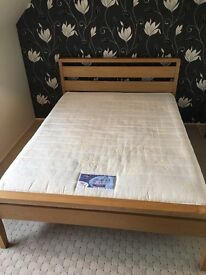 Kingsize wooden bed frame and mattress