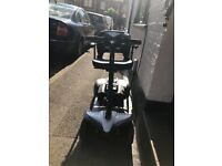 Style Plus 4mph portable mobility scooter & front & back LED lights, basket & lock.