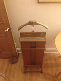 Antique standing wooden clothes valet