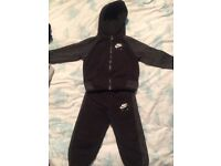 Two excellent condition tracksuits shed 12-18 months