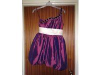 Above Knee length dress. Size 10. Purple dress with Jewel strap. Cream waist line design.