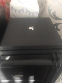 PS4 Pro with 20 games, 2 controllers and accessories