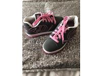 Girls Genuine heelys with tool to remove wheel and box size 1