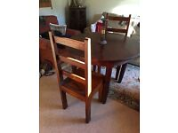 Round Mahogany Dining table and 4 chairs. Solid wood table diameter 1.00m.