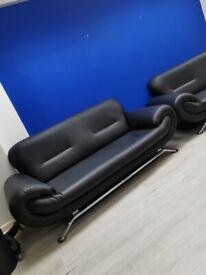 2x Black Leather Two seater sofas