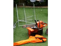 Petrol chainsaw with protective gear