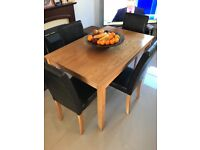 Oak effect dining table & 4 high backed chocolate chairs