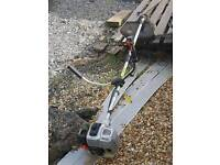 Large petrol strimmer with bull handles