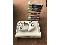 Xbox 360 console, complete with original box and 2 controllers and 20 games. Very good condition