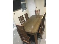 Table and 6 chairs hard wood