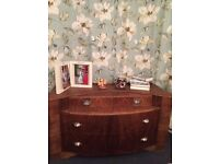 Gorgeous wood veneers chest of drawers with art deco handles