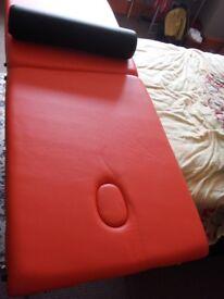 Unique orange massage bed.
