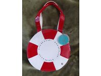 RED OR DEAD CREAM SHOPPER BAG AS NEW EXCELLENT CONDITION. 14 IN DIAMETER. LOADS OF STORAGE.
