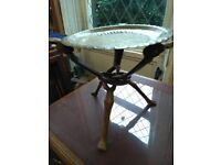 African wooden side table with brass top