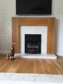 Fire surround with electric fire and marble hearth