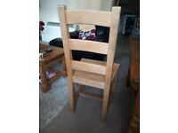 4 solid pine dining room chairs.