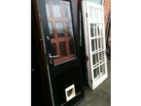 Exterior hardwood door with large crazed glass panel and cat flap