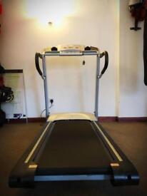 Running machine with brand new belt