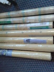 7 rolls of yellow wallpaper. all wrapped.