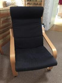 Black Ikea chair and matching footstool