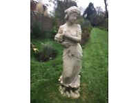 Classic stone garden statues, bird baths and urns