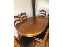 Beautiful oak dinning table with 6 dark brown leather chairs matching