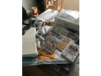 Wii with games, dance mat,wii board and hand sets.