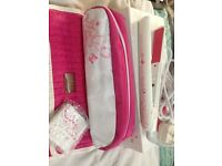 White and pink butterfly patterned GHD hair straighteners.