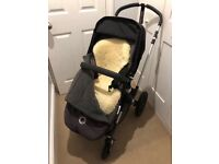 A Bugaboo Chameleon 3 in charcoal and black. Good condition.