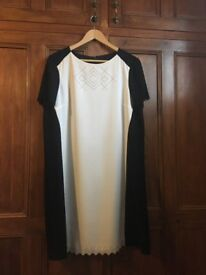 Hobbs Dress - worn once. Black and white size 16. Laser cut pattern on front. Straight shift style