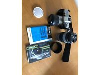 Minolta SLR camera with accessories and carry bag