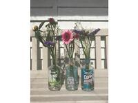 Mixed Adnams Gin bottles wedding decorations