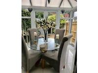 Glass table and suede grey chairs