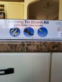 Awning tie down kit