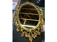 Mirror in ornate decorative gilt frame.