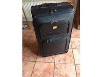 Large suitcase free to collector.