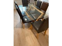Dining table glass top with solid oak 6 brown leather oak legged chairs £150