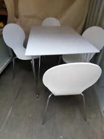 Dining room table and 4 chairs in white with stainless steel legs by John Lewis